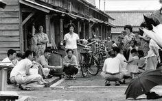 Street life by Isao Yamaguchi - neighbours in a coal-mining town in mid20thC Japan