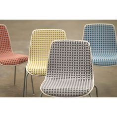 Chairs upholstered in Dot Grid by Elodie Blanchard