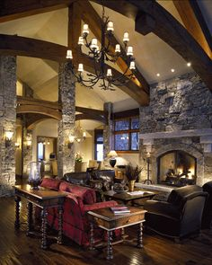 "With cream paint, stained wood trim and a ""stone"" fireplace, I'm envisioning a color scheme could be similar to this!"