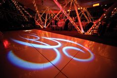 """Our huge white laquered dance floor with our """"G"""" (GLEASON) gobo which projected onto the floor. Provided by West Coast Event Productions and Hollywood Lighting"""