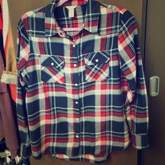 Blue and Red Flannel Pearl snaps and longer in the back. In excellent condition! Forever 21 Tops Button Down Shirts