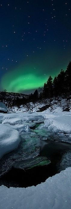 Northern Lights and Tennevik river in Troms, Norway
