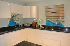 Glassification glass splashbacks- turquoise vanilla and pure silver. Installed in Northants