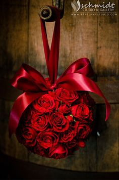 A pomander of red roses adds a touch of charm to your wedding day decor. Wedding Flowers, Wedding Décor, Roses