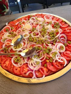 Insalata Siciliana --Tomatoes, Red Onions, Lemon Zest, Green Olives, and Extra Virgin Olive Oil