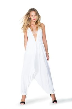 This gorgeous jumpsuit fits almost any size. The halter style top features a stylish plunge V neck. An adjustable drawstring secures the top, and tapers the waist line. Elegant open back design makes this the perfect showstopper for that boho fashionista. Of course there are hook-and-eye closures along the front and back to customize your amount of coverage. #designerjumpsuit