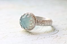 Wow that's pretty! Looks like something I'd see in Lord of the rings like elven jewelry lol. Blue Chalcedony Wedding Ring Set Crown Bezel & by ButtercupandCo, $80.00