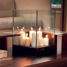 Cell | Decorpro Pillar candles surrounded by four glass walls sit atop a metal base. A simple way to create some ambience in your home or garden.