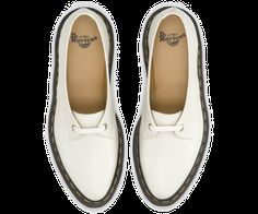 This dainty style is based on an archive photograph of Dr. Klaus Maertens fitting a women's shoe in the 1950s that was found in the brand's Heritage Museum in Northampton.  The 1-Eye Shoe is a very feminine cut, tapered and refined, with laces that are aged to suit the style. 1-Eye Shoe Off White Polished Smooth leather- a twist on the classic Dr. Martens leather: durable, with a smooth & polished finish Modern, pointed last Yellow stitch Goodyear-welted, the upper and sole are heat-sealed…