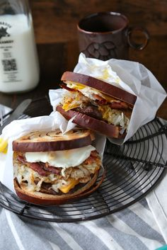 Cinnamon Swirl Loaded Breakfast Sandwich - www.countrycleaver.com Filled with bacon, sausage, hashbrowns and topped with a soft egg! You can't turn down this beast!