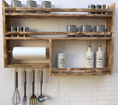 Spice shelf in old wood with kitchen roll! Dimensions approx.: Height 60 cm, Width 80 cm, depth 10 cm Incl. 4 hooks, without decoration, very sturdy, with kitchen roll
