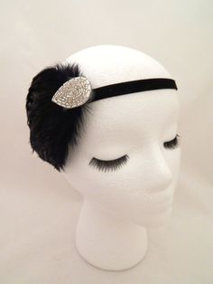 The Elsie  1920s black and silver feather headpiece by ShorelandChic on Etsy #1920s #feather #headpiece #greatgatsby #roaring20s #flapper #costumeheadband #beaded #blackandsilver #partyheadband #newyearsparty
