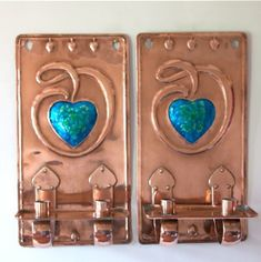 Pair of Arts and Crafts Wall Sconces by W. J. Neatby. Circa 1900. Rare pair of Arts and Crafts wall sconces in copper with central enamel heart design, riveted twin candle holders. Designed by William J Neatby Circa 1900 #artsandcraftsmovement,