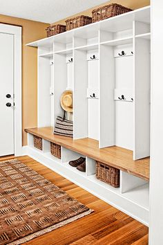 mudroom with open lockers for storage