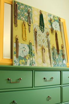 Painted plywood, prionted scrapbook paper, and Command Hooks created this unigue jewelry display by Kelly Berg @artestyling