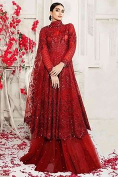 To complement your graceful demeanour, Andaaz fashion presents this red net sharara suit which is surely to set you apart from the rest. This closed neck and full sleeve party wear sharara suit is prettified with stone, sequins and thread work. Available with net sharara pants in red color with red net dupatta. Sharara pants has stone work. #shararasuits #malaysia #Indianwear #weddingwear #andaazfashion Pakistani Maxi Dresses, Pakistani Bridal Dresses, Bridal Lehenga, Hijabi Gowns, Pantalon Cigarette, Lehenga Online, One Piece Dress, Types Of Dresses, Bridal Collection