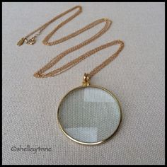 Gold Magnifying Glass Pendant From LA-based brand, Stella & Bow: magnifying glass pendant suspends from a 14k gold-filled chain Stella & Bow Jewelry Necklaces