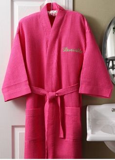 Step out of the bath or shower in signature style with our personalized fuchsia pink robe and makeup bag. Fashionable pink kimono style robe and coordinating cosmetic bag feature stylish waffle-weave texture ready for you to sink into for a comfy, cozy morning or night. Both are custom embroidered w...