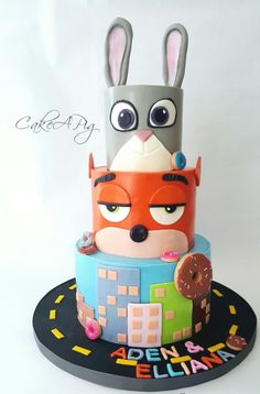 Zootopia Cake inspired by Hot Mama's Cakes. everything hand made with fondant. vanilla cake with cream cheese filling, and Liz Marek's Easy Buttercream under the fondant