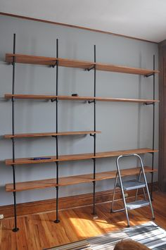 for Kylers' room ~ book shelf system with tv