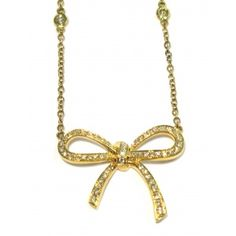 Custom designed by Alan Friedman 18kt yellow gold white diamond bow necklace set with 64 round brilliant cut white diamonds equaling 0.46 carats total wight