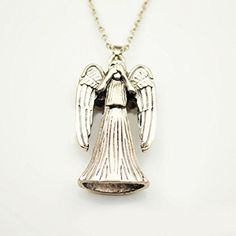 "Doctor Who: Weeping Angel Necklace. Doctor Who Weeping Angel Necklace. Pendant measures approx. 1 3/8"" long by 1 1/4"" wide. Chain measures approx. 16 inches long. One size fits most teens and adults."
