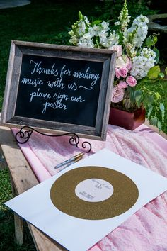 """""""thanks for making music with us - please sign our poster"""" guest book #awesomeguestbook #recordstheme #beunique http://www.weddingchicks.com/2013/11/05/music-themed-wedding/"""