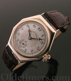 An early 9ct rose gold octagonal vintage Rolex Oyster watch, 1927