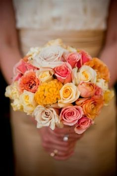 I would probably add daisies, and replace those yellow cerebrum looking things with white hydrangea.  Possible bride's bouquet?