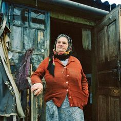 Maria Urupa, 77, on her porch in Parishev village near Chernobyl. When the authorities evacuated the village days after the accident, Maria's first thought was to hide in the basement with her cow. On her return to Parishev after a few months, all the animals had been killed. Photo: RENA EFFENDI/ INSITUTE