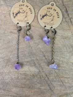 Earrings Amethyst Crystal Point  by Lily in Flux. American Made. See the designer's work at the 2016 American Made Show, Washington DC. January 15-17, 2016. americanmadeshow.com #americanmadeshow, #americanmade, #jewelry, #earrings, #amethyst, #purple