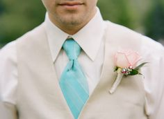 Grooms attire - love the turquoise tie and blush boutonniere  #wedding #groom #suits