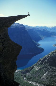Trolltunga, Norway. I would fall off the instant my stomach hit my feet!!