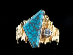 Ring  by Ted Charveze (Isleta Pueblo)          Gold, Indian Mountain diamond, turquoise