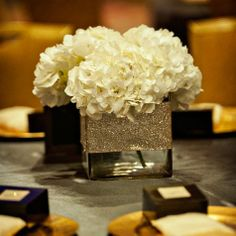 White Hydrangea Centerpiece- could replace sparkles with burlap.