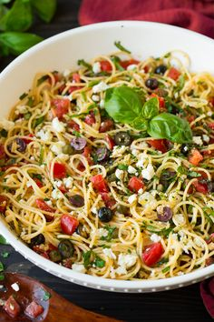 Garlicky Greek Spaghetti Toss -   Made with tender spaghetti, fresh tomatoes, zesty olives, tangy feta, plenty of fresh herbs and finished with a robust garlicky olive oil. So delicious!