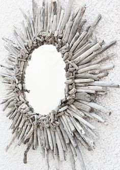 DIY sunburst mirror... i want drift wood from AK to make one of these.