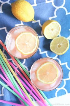 Healthy Strawberry Lemonade in glasses with sliced lemon on blue background