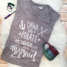 Drink like a pirate, dance like a mermaid... This v neck tee will make you TURN SOME HEADS! Very soft and super comfy!  Represent being a fabulous mermaid 24/7.  Please notate design color choices. If no color choices are left, Ill pick something cute. Shirts come in crew neck, v neck or racerback.  This top runs true to size. If you prefer a looser fit then Id suggest ordering a size larger than normal. Be sure to view the size chart in the photos. :)  *****PLEASE BE SURE TO NOTATE THE ...
