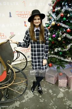 Ciara Bravo joins Delta Air Lines and YMCA of Greater New York for the Fourth Annual 'Holiday in the Hangar,' a special holiday celebration for PS 154 elementary school students, at JFK on December 3, 2014 in New York City.
