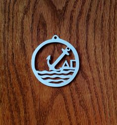 Handmade, one of a kind Delta Gamma ornament cut from a scroll saw. Ornament is 2.75 in diameter. This ornament is perfect for Christmas or as a