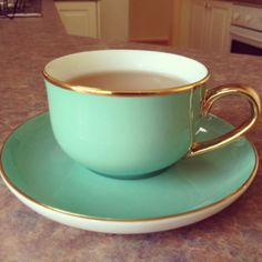 Aqua teacup with gold trim and handle