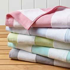 Our luxury beach towels come in an array of colors and designs, including personalized options. Our Frontgate towel stands and storage make poolside cleanup a breeze. Luxury Beach Towels, Large Beach Towels, Striped Towels, Striped Rug, Bath Travel, Banana Palm, Egyptian Cotton Towels, Tropical Pool, Fingertip Towels