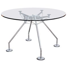 The Nomos Table designed by Norman Foster | From a unique collection of antique and modern tables at https://www.1stdibs.com/furniture/tables/tables/