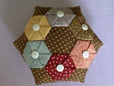 Polka Dot Pineapple: Hexagon Yo-Yo Pincushion - a tutorial for folding the hexi's can be found here: http://mousechirpy-polkadotpineapple.blogspot.com/2008/06/tutorial-folded-hexagon-yo-yo.html