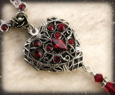 This silver and red pendant necklace would be perfect to go with my daughter's dress for prom.