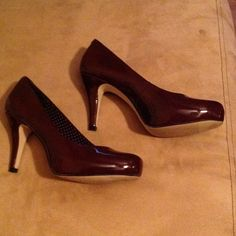 Patented leather burgundy heels These patented leather beauties are a must have.  Beautiful burgundy heels, have somewhat of a square toe.  Very comfy. Madden Girl Shoes Heels
