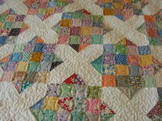 2 block quilt...Block of 4 sqs  with white sq with 2 corners half-sqd.  This would look amazing on point!