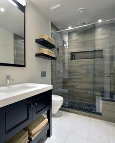 cool wood grain porcelain shower and river rocks! (stephen belyea