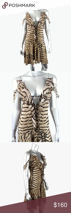 "Roberto Cavalli Snake Reptile Deep V Dress I023 Authentic Roberto Cavalli sleevless dress with deep v-neckline that ties in the front, rope straps. The fabric content tag is too faded to tell what the fabric is, but it feels like it may be silk and/or viscose. Signature fabric. Made in Italy. • 16.5"" armpit to armpit • 15"" across the waist • 36"" length from top of shoulder to bottom hem • Excellent condition, no flaws.  All pictures are my own & of the actual item for sale. Roberto Cavalli…"